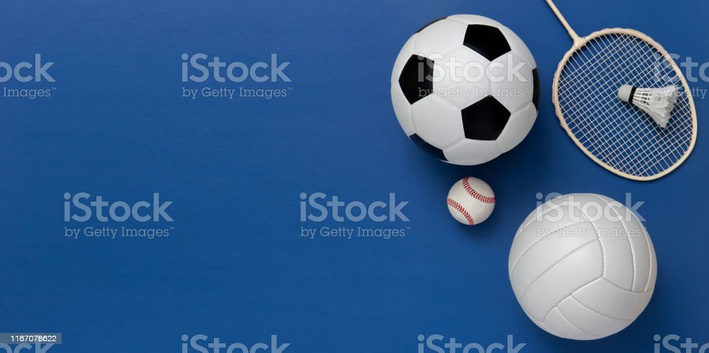 Assorted sports equipment including a basketball, soccer ball,...