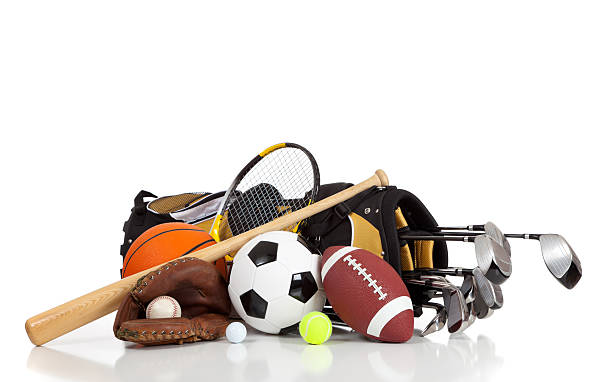 Assorted sports equipment on a white background stock photo