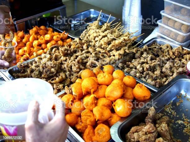 Assorted street food at a food stall picture id1069572132?b=1&k=6&m=1069572132&s=612x612&h=zhh1w1wmkyap2ogukxsc1tothmrkdomicam18ztk ti=