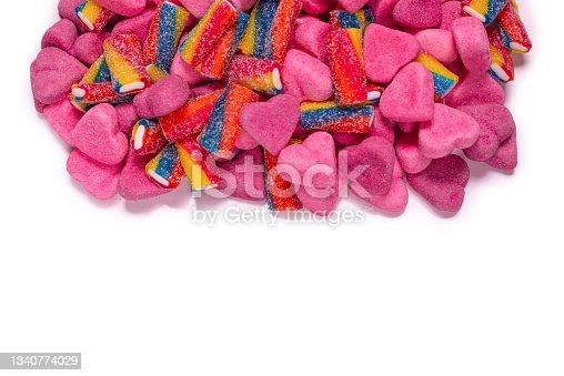 istock Assorted tasty gummy candies. Pink jelly sweets background. 1340774029