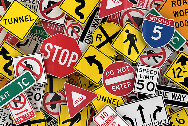 assorted traffic sign wallpaper - road signs stock pictures, royalty-free photos & images