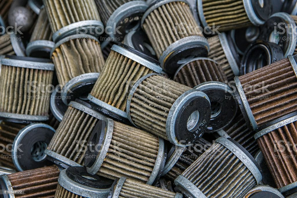 Assorted used oil filter motorcycle and car stock photo