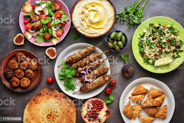 Assorted variety of arabic and middle eastern food on a dark rustic picture id1170104556?b=1&k=6&m=1170104556&s=612x612&h=c0otcdttovke6kw62xnh 03simrzrrodqcm6oaszcuu=