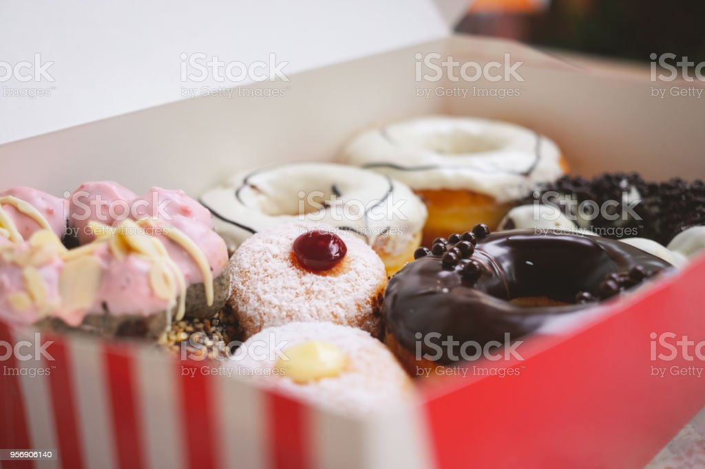 Assorted various of donuts with cream and powder glazed stock photo