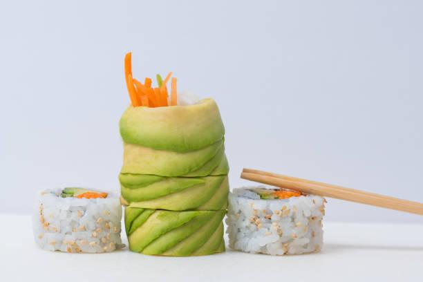 Assorted vegan sushi on white background stock photo