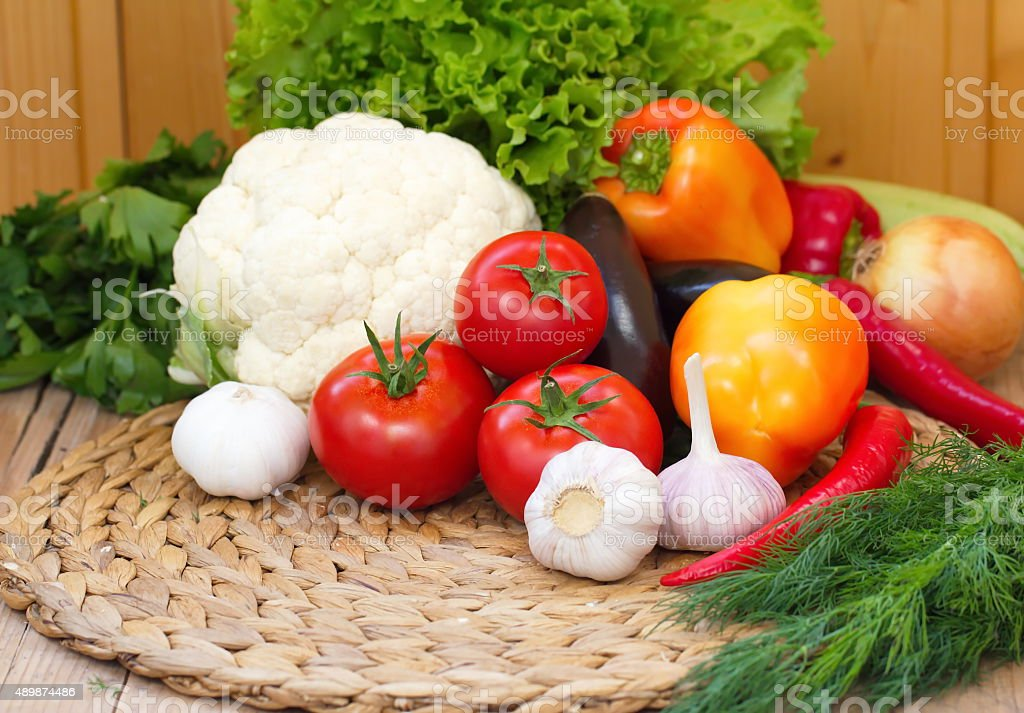 Assorted vegetables on the wooden table stock photo