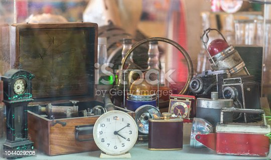 A display of interesting, old fashioned items and trinkets in a pawn shop.
