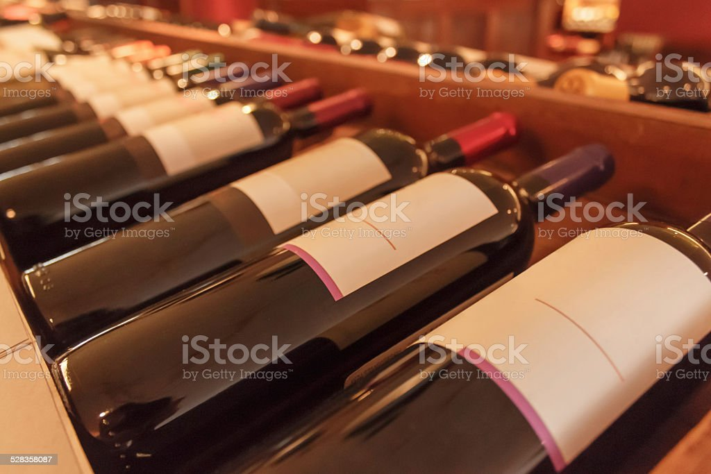 Assorted wines stored in the a wooden cellar stock photo