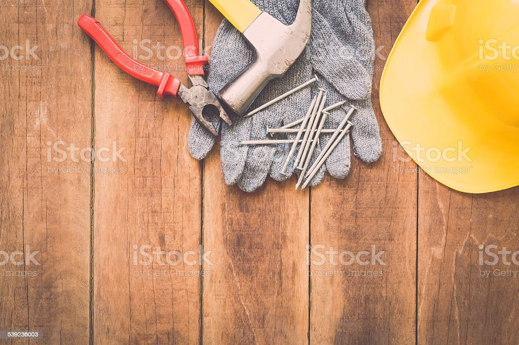 Assorted work tools on wood royalty-free stock photo