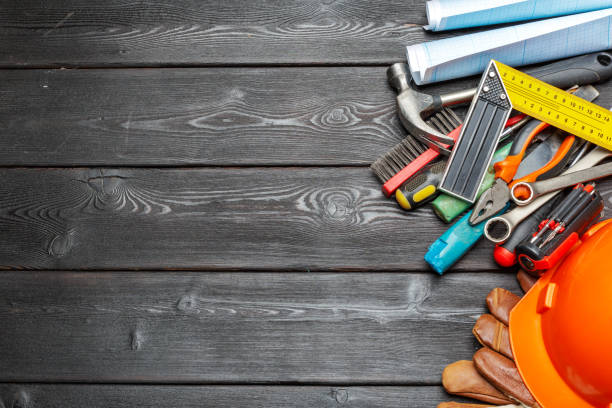 Assorted work tools on wooden table Assorted work tools on wooden table craftsperson stock pictures, royalty-free photos & images