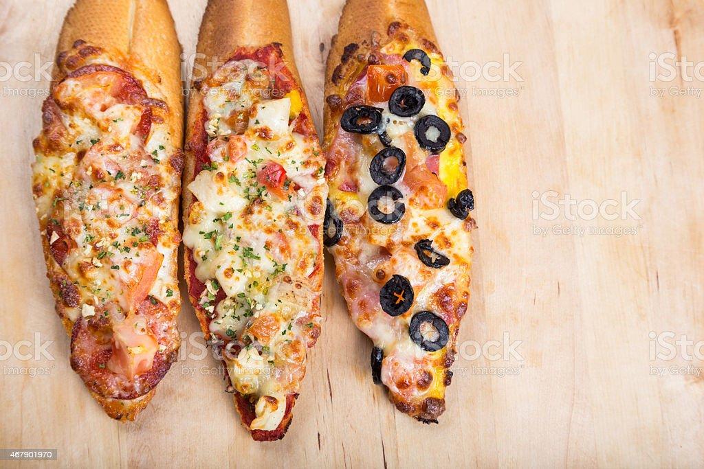 assorti bruscjetta with sausage, cheese, tomato fron big white b stock photo
