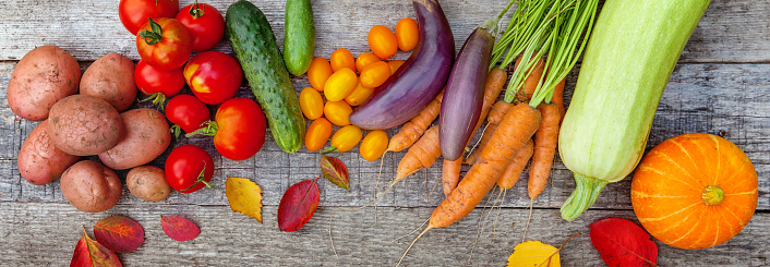 istock Assortment different fresh organic vegetables on country style wooden background 1158155721