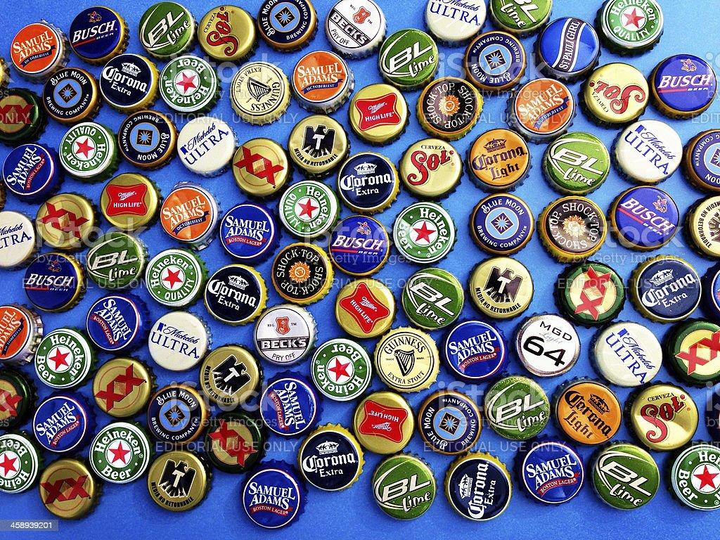 Assortment of beer bottle caps stock photo