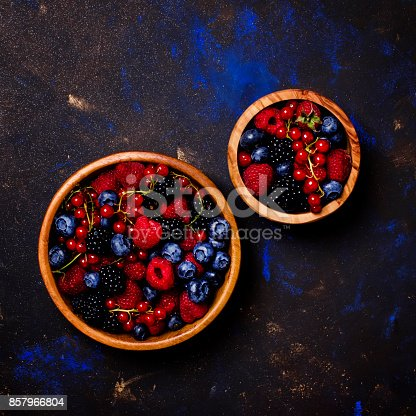 841659594 istock photo Assortment of berries in wooden bowls 857966804