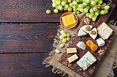 istock Assortment of cheese with honey, nuts and grape 537318588