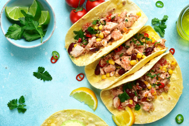 assortment of chicken tacos - traditional dish of mexican cuisine - tortilla stock photos and pictures