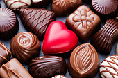 Assortment of chocolate candies, white, dark, milk chocolate Sweets background
