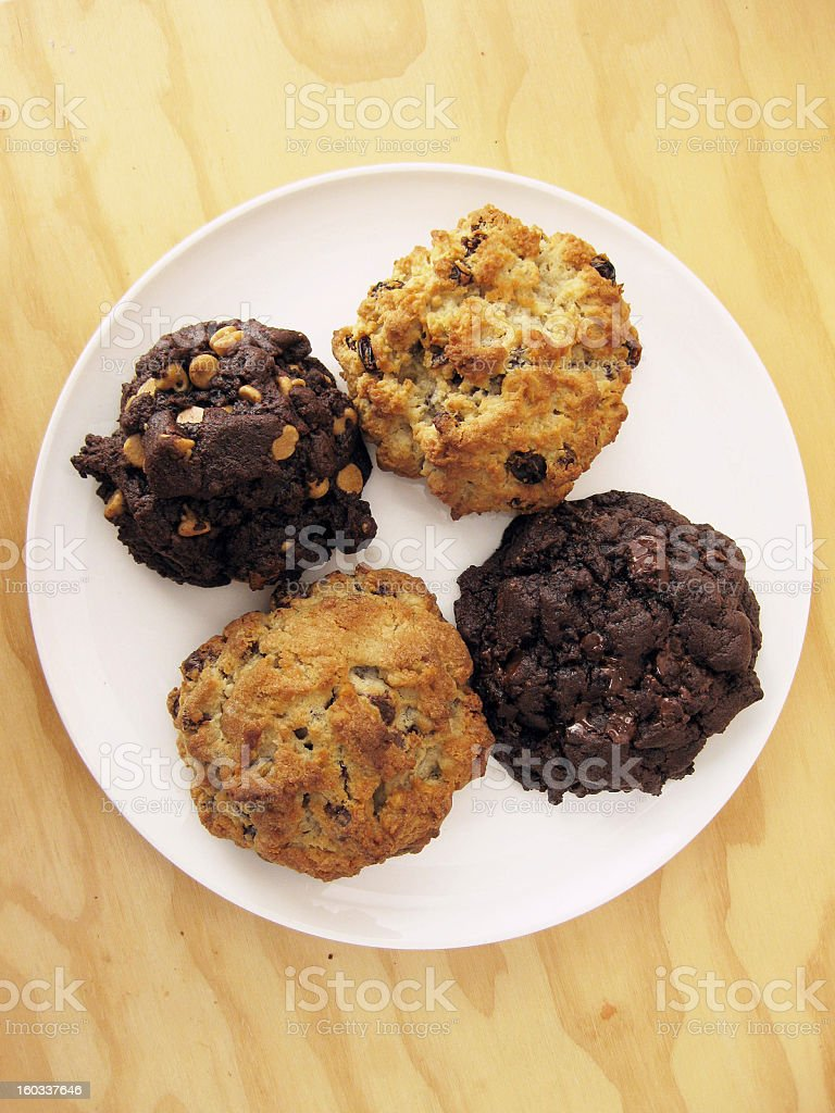 Assortment of Chocolate, Oatmeal Raisin, and Chocolate-Chip Cookies stock photo
