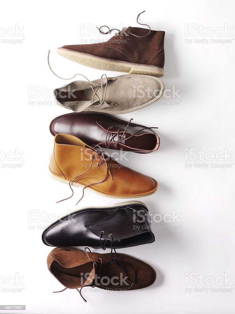 Assortment of chukka boots on a white background stock photo
