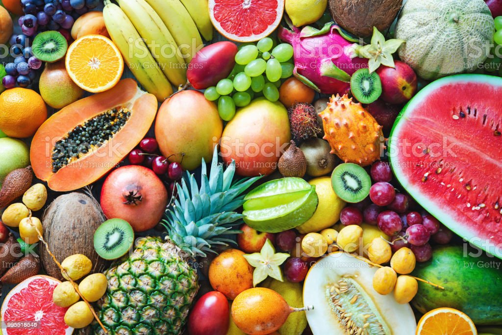 Assortment of colorful ripe tropical fruits. Top view stock photo