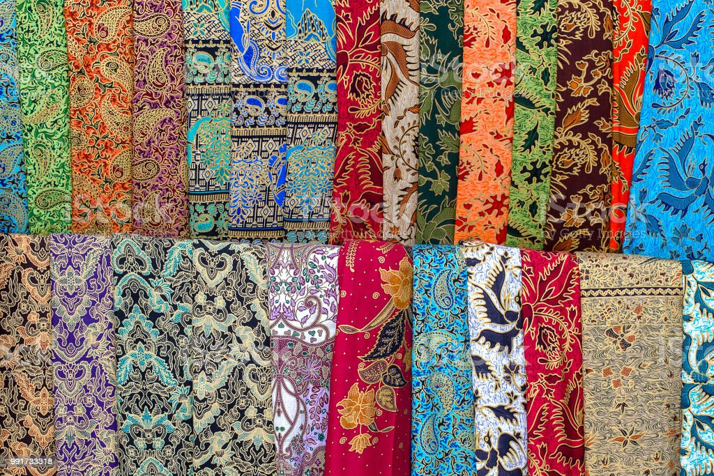 Assortment of colorful sarongs for sale in local market, Island Bali, Indonesia. Close up stock photo
