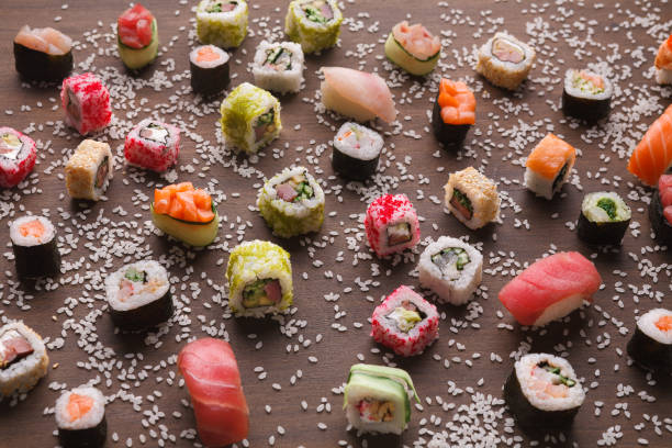 assortment of colorful sushi and rolls background - sport set competition round stock photos and pictures