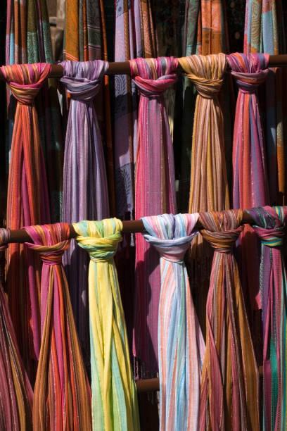 Assortment of coloured textiles stock photo