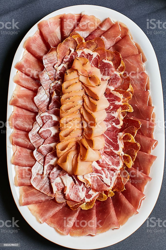 Assortment of delicatessen cold meat, salami, ham and bacon stock photo