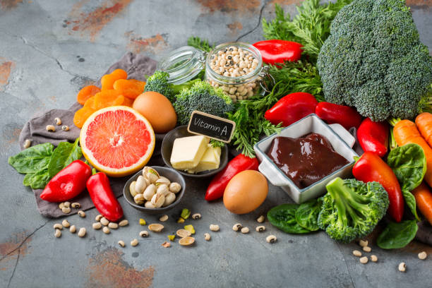 Assortment of diet food ingredients rich in vitamin a stock photo