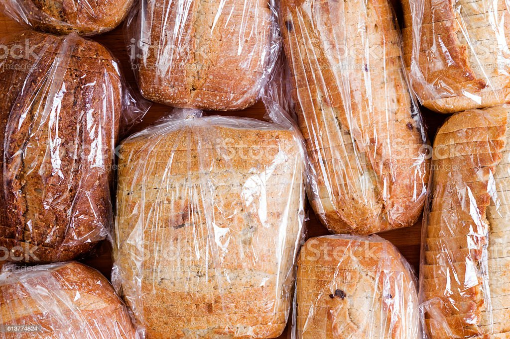 Assortment of different sliced loaves of bread stock photo