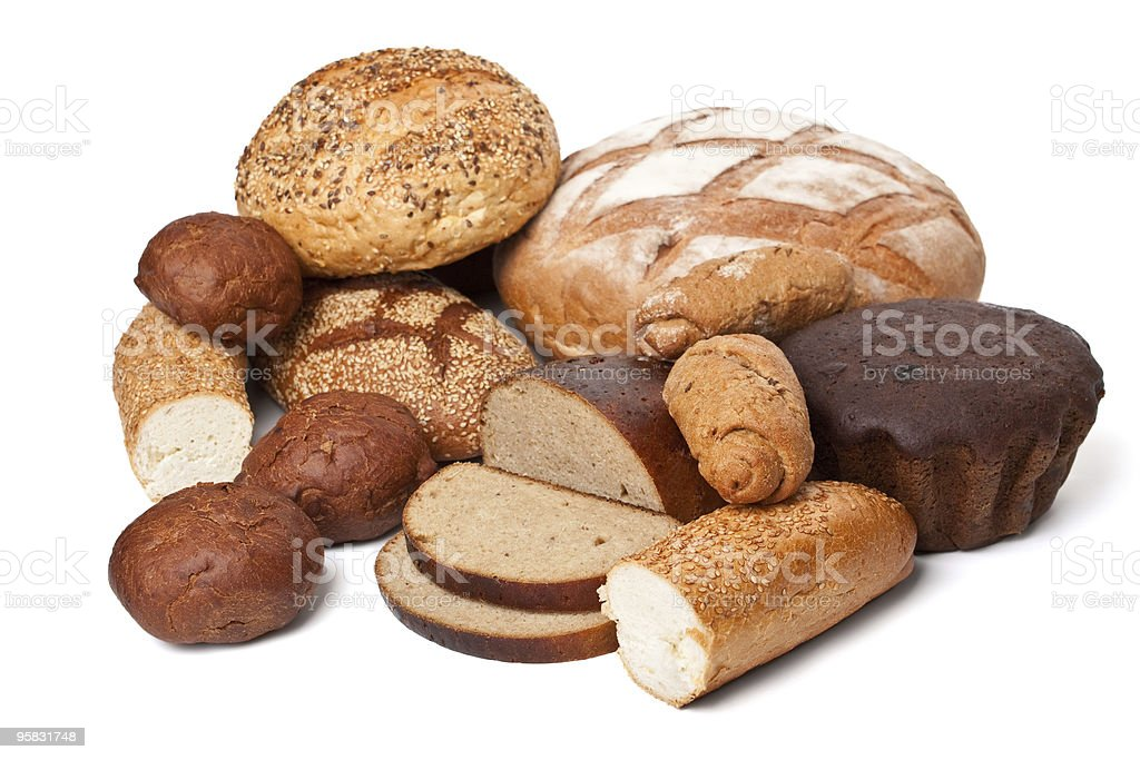 Assortment of different types of bread on white surface royalty-free stock photo