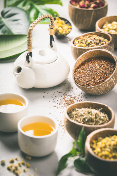 Assortment of dry tea in coconut bowls. stock photo