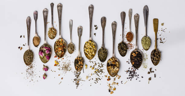 Assortment of dry tea in vintage spoons stock photo