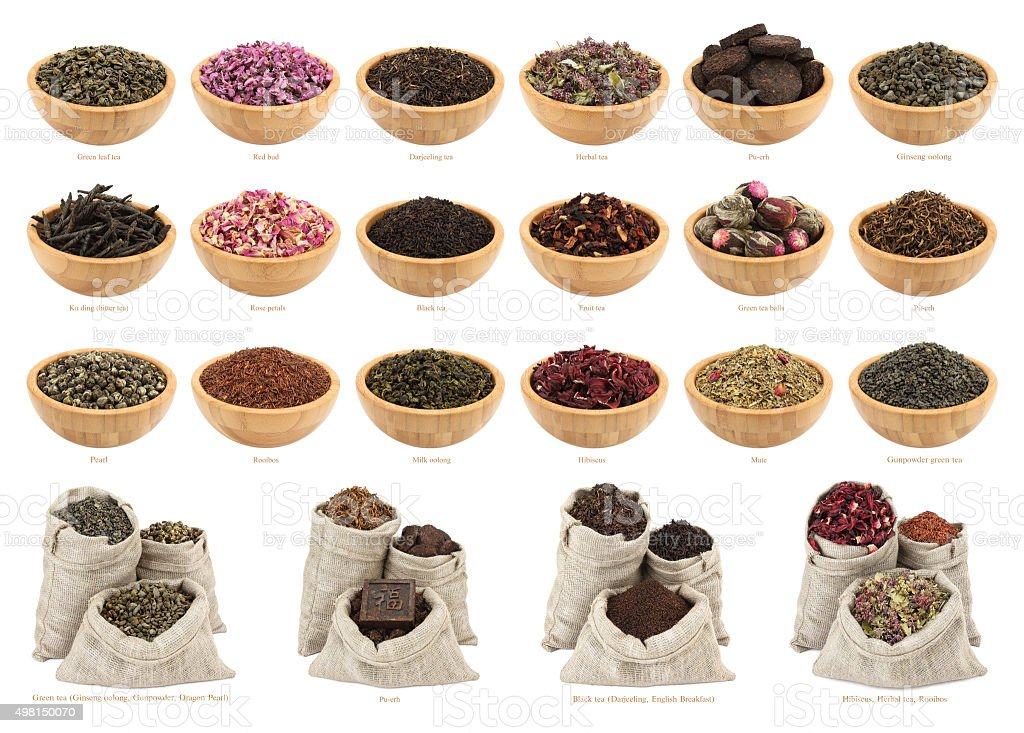 Assortment of dry tea in wooden bowls and fabric bags stock photo
