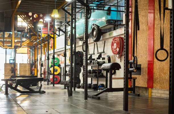 Assortment of exercise equipment inside of a gym stock photo