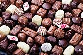 Assortment of fine chocolate candies, white, dark, and milk chocolate. Sweets background