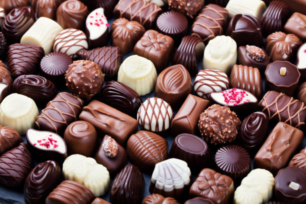 assortment of fine chocolate candies, white, dark, and milk chocolate. sweets background. - cioccolata foto e immagini stock