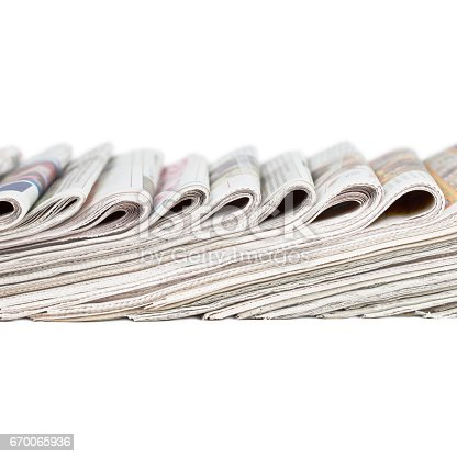 istock Assortment of folded newspapers 670065936