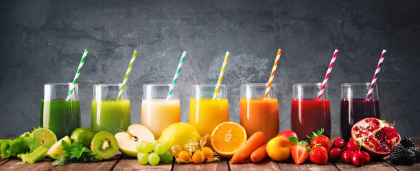 Assortment of fresh fruits and vegetables juices in rainbow colors stock photo