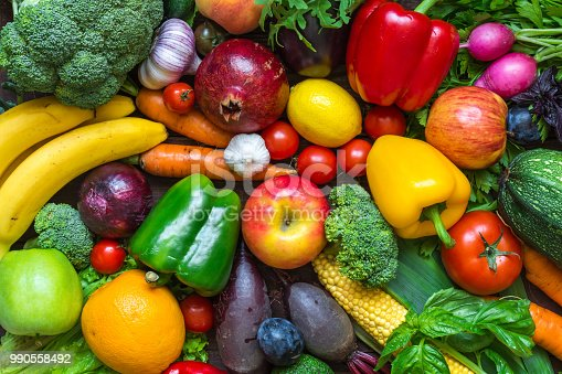 istock Assortment of fresh harvested fruits and vegetables on the table 990558492