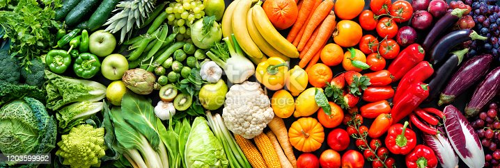 istock Assortment of fresh organic fruits and vegetables in rainbow colors 1203599952