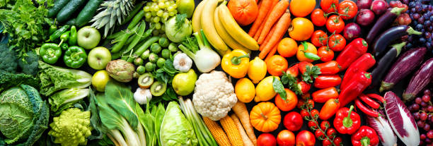Assortment of fresh organic fruits and vegetables in rainbow colors Panoramic food background with assortment of fresh organic fruits and vegetables in rainbow colors fruit stock pictures, royalty-free photos & images
