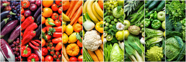 Assortment of fresh organic fruits and vegetables in rainbow colors stock photo