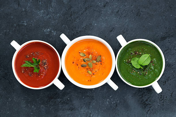 assortment of fresh vegetable soup on a dark background assortment of fresh vegetable soup on a dark background, top view vegetable soup stock pictures, royalty-free photos & images