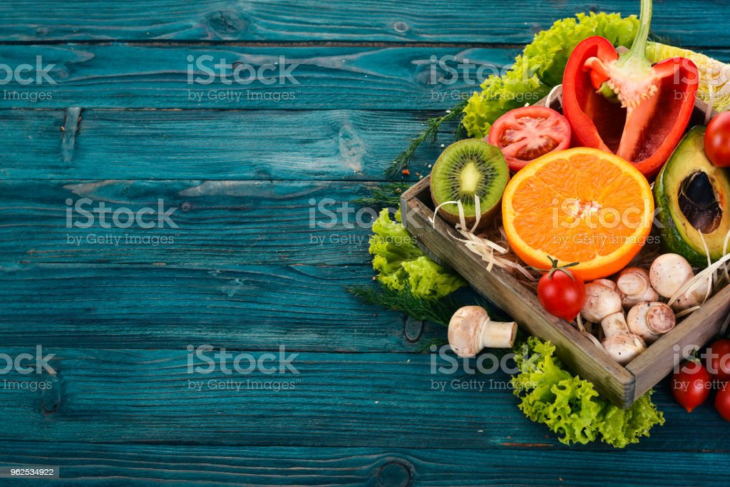 Assortment of fresh vegetables and fruits. Healthy food On a blue wooden background. Top view. Copy space. - Royalty-free Agriculture Stock Photo