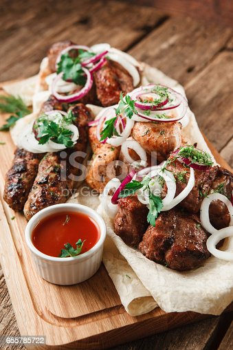 655793486 istock photo Assortment of grilled meat. Appetizing lunch. 655785722