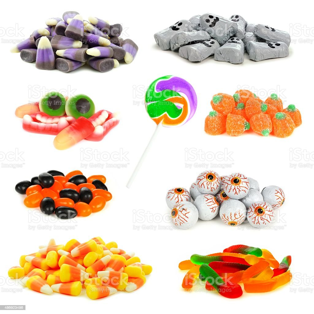 Assortment of Halloween candies in isolated piles stock photo