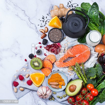 854725402 istock photo Assortment of healthy food, superfood ingredients for cooking on table 1205311169