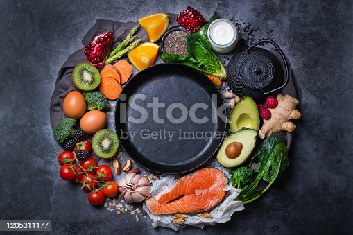 854725402 istock photo Assortment of healthy food, superfood ingredients for cooking on table 1205311177