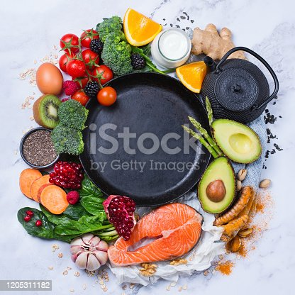 854725402 istock photo Assortment of healthy food, superfood ingredients for cooking on table 1205311182